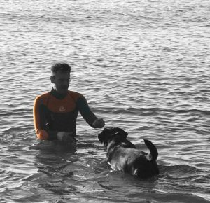 Marcus Santer swimming in the Devon sea with his dog, Louis